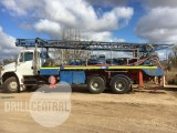 Mayhew 1000 Table Drive drill rig mounted on Freightliner with Spicer 10spd box
